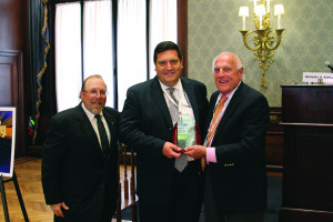 The Honorable Jerrold N. Poslusny Jr. (center) accepts his award for his victory in Judicial Jeopardy from ABF Journal publisher Jerry Parrotto (right) while flanked by Kaplan (left).